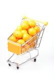 Kumquat in shopping cart Royalty Free Stock Images