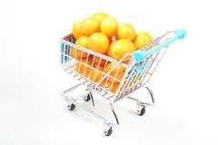 Kumquat in shopping cart Royalty Free Stock Photography