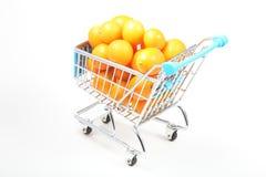 Kumquat in shopping cart Royalty Free Stock Photography