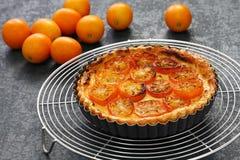 Kumquat tart, homemade dessert. Kumquat, its raw rind is sweet, with the flesh is sour like the lemon stock photography