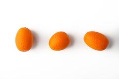 Kumquat on the white background Royalty Free Stock Photos