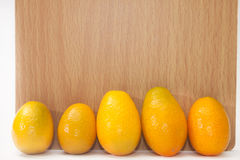 Kumquats in front of the blank message board Stock Photos