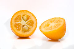 Kumquats Split. Fresh Kumquat split in two Stock Photos