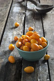 Kumquats on a wooden rustic table Stock Photography