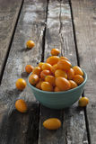 Kumquats on a wooden rustic table Royalty Free Stock Photo