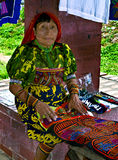 Kuna Woman, Panama. A woman of the Kuna people, indigenous to Panama, Central America, sits in a marketplace in Portobelo, on the Caribbean coast, selling Royalty Free Stock Photos