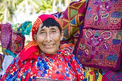 Kuna woman, Panama with traditional art works  - Molas,. Indigenous woman of the Guna Isla Aguja, San Blas Islands, Panama, with their traditional molas Royalty Free Stock Image