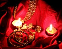 Kundan jewelry in red background in candle light Stock Image