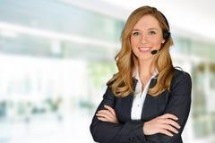 Kundendienst eine schöne lächelnde Geschäftsfrau Stockbild