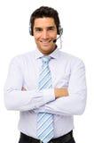 Kundendienstmitarbeiter Standing Arms Crossed Lizenzfreie Stockfotos