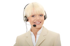 Kundenkontaktcenterfrau mit Kopfhörer Lizenzfreies Stockfoto