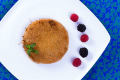Kunefe Dessert a Blue Table with Berries Royalty Free Stock Image