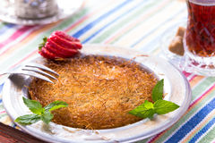 Kunefe, Turkish Dessert with hot tea Royalty Free Stock Image