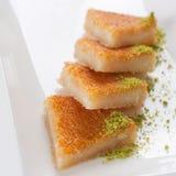 Kunefe, Turkish sweet. Close up shot of Turkish sweet, kunefe, with pistachios stock photography