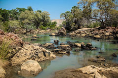 Kunene River, Namibia. In the north of the country, the mighty Kunene River forms part of Namibia's border with Angola for about 325km (202miles). Winding royalty free stock images