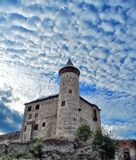 Kuneticka hora castle against dramatic blue sky Stock Photo