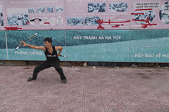 Kung fu fighter. Student practise kung fu on the street of Ho Chi Minh in Vietnam Stock Photography