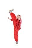 Kung fu girl high kick. On white Royalty Free Stock Photos