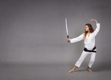 Kung fu with katana on hand stock image