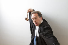 Kung fu lawyer. Man in canadian laywer robe with a gavel in hand in fake kung fu fighting form Stock Photography