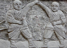 Kung Fu monk sculpture. Two Kung Fu monk sculpture inside Shaolin Temple songshan dengfeng city henan province China Stock Images