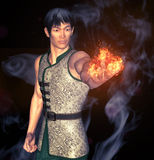 Kung Fu Power. 3d render of a kungfu fighter with a globe of fire Stock Photography