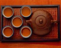 Kung fu tea set. Chinese kung fu tea set five cups of tea and a ceramic pot stock photos