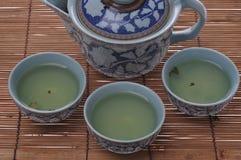 Kung fu tea set. Chinese kung fu tea set three cups of tea and a ceramic pot stock photo