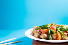 Kung pao chicken on blue background Stock Photos