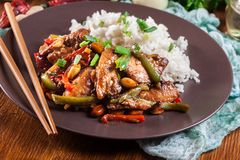 Kung Pao chicken with peppers and vegetables. Served with rice. Traditional sichuan dish Stock Photography