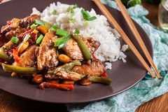 Kung Pao chicken with peppers and vegetables. Served with rice. Traditional sichuan dish Stock Image