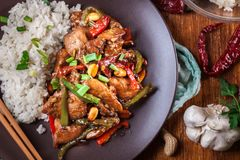 Kung Pao chicken with peppers and vegetables. Served with rice. Traditional sichuan dish. Top view Royalty Free Stock Image