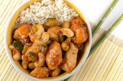 Kung Pao chicken with rice and chopsticks Royalty Free Stock Photography