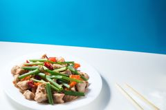 Kung pao chicken on white table Stock Photo