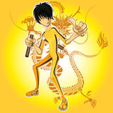 Kungfu Master. Wearing Yellow Jumpsuit Playing Nunchucks With Dragon Tatoo Royalty Free Stock Photo