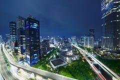 Kuningan CBD i Jakarta på nattplatsen Royaltyfri Bild