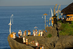 Kuningan Festival, Bali Indonesia. Balinese people at Tanah Lot Temple on FBRUARY 23, 2016 in Bali, Indonesia during the Kuningan festival, one of the most stock image
