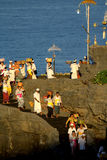 Kuningan Festival, Bali Indonesia. Balinese people at Tanah Lot Temple on FBRUARY 23, 2016 in Bali, Indonesia during the Kuningan festival, one of the most stock images
