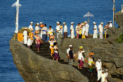 Kuningan Festival, Bali Indonesia. Balinese people at Tanah Lot Temple on FBRUARY 23, 2016 in Bali, Indonesia during the Kuningan festival, one of the most royalty free stock image