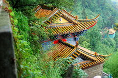 Kunming, China: Dragon Gate Temple. The Dragon Gate Temple with its flying eave roofs built high into the verdant hillsides at Westside Mountain Park outside of stock photography