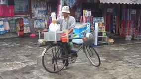 Kunming, China - 08/25/2012: Man making cotton candy on a bicycle stock video