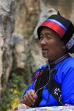Old Yi woman singing for the tourists at the Stone forest in Kunming, Yunnan province, China also know as Shilin Stock Photography