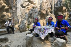Old Yi women singing for the tourists at the Stone forest in Kunming, Yunnan province, China also know as Shilin Stock Photography