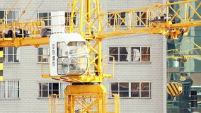 18.05.2019 Kunming, China- Operating crane on construction site in Chinese city stock video