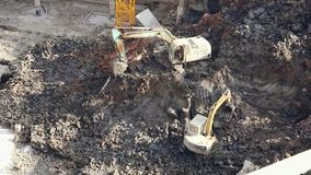 18.05.2019 Kunming, China- Operating excavators on construction site in Chinese city stock video footage
