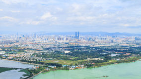 Kunming City Viewpoint in Panorama, Capital City of Yunnan. Cityscape Panorama of Kunming City from Viewpoint on Xi Chan Mountain, Yunnan, China Stock Photo