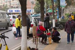 Chinese people on the sidewalk royalty free stock photo