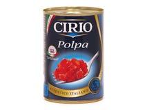 Kunna av Cirio Polpa, h?gg av tomater royaltyfria bilder