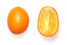 Kunquats. Orange Kumquats - One Cut in Half Royalty Free Stock Photos
