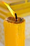 Kunst der gelben Kerze Stockbild